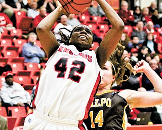 Youngstown State's Brandi Brown (42) gets past Valparaiso's Tabitha Gerardot (14) on her way to a layup Monday night at Beeghly Center. Brown scored 18 points in the Penguins' 72-50 victory. Brown reached the 2,000-point milestone for her career at YSU.