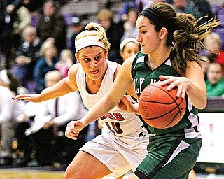 Canfield's Paige Baker (10) keeps a close watch on Holy Name's Rachael Kucharcyzk (33) during the Division II regional semifinal Tuesday at Barberton High School. The Cardinals downed the Green Wave, 52-30.