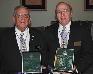 SPECIAL TO THE VINDICATOR At a recent meeting of Argus Lodge of Canfield, its annual inspection was completed and James C. Feist, left, and David L. Collins, of the 24th Masonic District, were presented with plaques by Russell W. Gillam Jr. for attending 300 consecutive lodge inspections. When Feist and Collins joined in 2002, there were 31 lodges in the district, now there are 25. Each lodge has an inspection annually, and these men have not missed one in the past 11 years. They are the first in the district to attain this accomplishment.