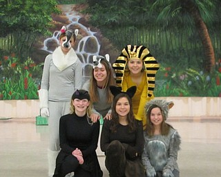 "Neighbors | Natalie Scott.A group of students show off their costumes for the middle school production of ""The Jungle Book"" during rehearsal Feb. 22."