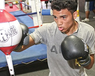"""Boxer Alejandro """"Popo"""" Salinas, shown here working out at the Southside Boxing Club, will headline Saturday's amateur boxing show at the Saxon Club."""