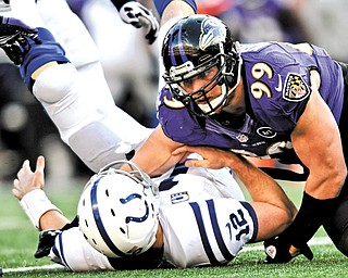 Baltimore Ravens outside linebacker Paul Kruger (99) sacks Indianapolis Colts quarterback Andrew Luck (12) during the second half of a wild-card playoff game in Baltimore. Kruger agreed to terms Tuesday on a contract with the Cleveland Browns.