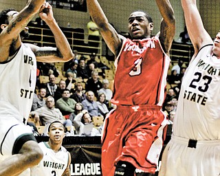 Youngstown State's Kendrick Perry (3) drives against Wright State's Jerran Young (4) and A.J. Pacher (23) during a Horizon League tournament game Friday at Valparaiso. The Penguins lost, 66-59, but Perry and his teammates aren't finished. YSU has accepted a bid to the CollegeInsider.com tournament.