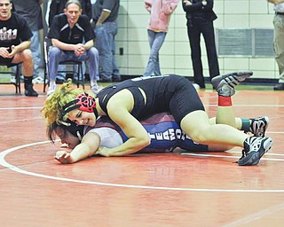 Corri Sayre, top, who gets to pin boys as a member of the Howland junior varsity wrestling team, will be wrestling girls this weekend at the United States Girls Wrestling Association national championships at Eastern Michigan University.