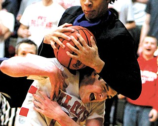 Youngstown Christian's KaeVon Green (24) pulls down a rebound along with Hannibal River defender Brett Price (21) during the Division IV regional semifinal Tuesday at Canton Memorial Fieldhouse. The Eagles downed the Pilots, 60-49, to advance to the final today against Villa Angela-Saint Joseph. Tip-off is set for 7:30 p.m.