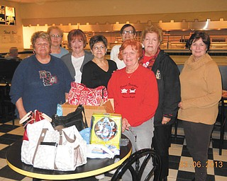 SPECIAL TO THE VINDICATOR Tri-Gold Chapter of the American Business Women's Association will sponsor its annual basket auction April 6 at Christ Our Savior Parish at St. Nicholas Church, 764 Fifth St., Struthers. Doors open at 12:30 p.m. with drawings starting at  3:30 p.m. Admission is $5 and includes a full sheet of raffle tickets and door prize entry. There will be free light refreshments, cash door prizes, a 50-50 raffle and cash hat raffle. All proceeds will go to scholarship and education programs. Shown are board officers and members making plans for the auction. In front from left are Kay Meyers, secretary; Donna Farmer; Kathleen Poorman; Elena Nigro, vice president; Sarah Janutolo; and Sharon Pasquale, treasurer. In back are Dolly Sonnenlitter, president; and Mary Ann David.