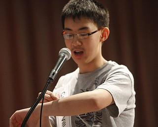 ROBERT  K.  YOSAY  | THE VINDICATOR --..Max Lee - the Champion - and his visual aid as he spells and says the word ..The 80th  Youngstown Vindicator Spelling Bee was held at Kilcawley Center on YSU Campus  Saturday morning with  60 competitors from area schools.. ..(AP Photo/The Vindicator, Robert K. Yosay)
