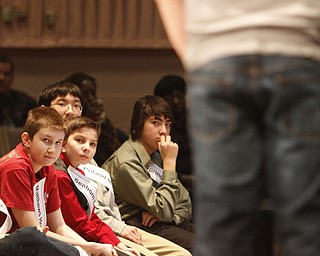 ROBERT  K.  YOSAY  | THE VINDICATOR --..Watching  a competitor is Ronnie Matthews  - Matthews Home School  Justin Brown -Seaborn  Elementary --  Noah Lee Poland Middle Schoo andKazi Ervin from Springfield Middle -.. The 80th  Youngstown Vindicator Spelling Bee was held at Kilcawley Center on YSU Campus  Saturday morning with  60 competitors from area schools.. ..(AP Photo/The Vindicator, Robert K. Yosay)