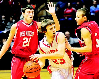 LaBrae senior John Richards (23) looks to pass while West Middlesex's Jerrod Palmer (5) and Jeremy Jansco (21) defend during a Jan. 20 basketball game at the Covelli Centre. LaBrae will play in the Division III state semifinals on Thursday in Columbus.