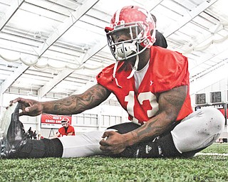 Youngstown State running back Adaris Bellamy works out at Tuesday's football practice at the WATTS. Since last season the former hotshot recruit from South Florida has undergone a host of changes including becoming a pescetarian, losing weight and gaining perspective, all in an attempt to shed his past baggage in the same way he shed his knee brace.