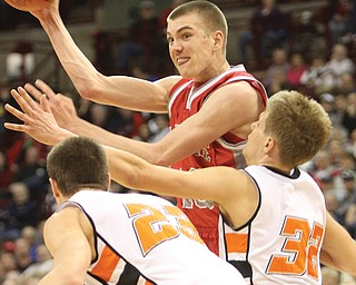 LaBrae's Peyton Aldridge (10) passes over Versaillies Damien Richard (23) and Chad Winner (32) during the boys Division III state semifinal basketball game Thursday at Ohio State University's Value City Arena in Columbus. Aldridge had 23 points and nine rebounds for the Vikings, whose season came to an end in a 64-52 loss to the Tigers.