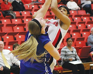 Youngstown State's Shar'Rae Davis (4) goes for a jump shot against Indiana State defender Natasha Zurek during their game Thursday during Round 1 of the WNIT at YSU's Beeghly Center. The Penguins cut down the Sycamores, 63-51.