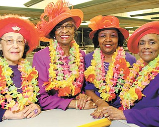 William D. Lewis | The Vindicator A String of Pearls of the Red Hat Society is preparing for the seventh annual International Red Hat Day luncheon at 10 a.m. on April 17 at Our Lady of Mount Carmel Hall. From left are Carol Donnelly, Queen Mum; and committee members, Louise Adams, Juanell Patton and Iva Harrell.