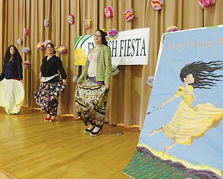 Marilyn DeJesus, center, a teacher of English as a second language at P. Ross Berry Middle School, leads students Keysa Villafane, left, and Abigail Jimenez in a Mexican dance as part of the school's English Fiesta on Thursday at the school.