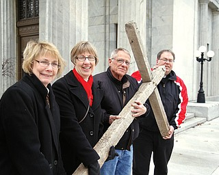 Members of Niles Clergy Association, from left, the Revs. Cynthia Carlisle, Cynthia Klingemier, David Conrad and Thomas Kraszewski, will carry a wooden cross for today's observance of Good Friday.