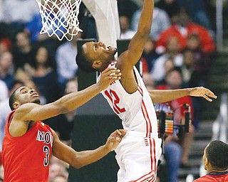 Ohio State's Sam Thompson beats Arizona defender Kevin Parro to the rim for a basket in the second half of their game in the West Region of the NCAA Sweet 16 on Thursday at the Staples Center in Los Angeles. A late 3-point shot by the Buckeyes' LaQuinton Ross gave OSU the 73-70 win.