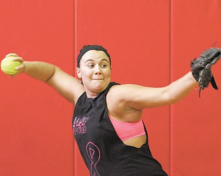 Mathews' Jacki Rhine makes a throw during practice Monday. Mustangs coach Jim Nicula returns most of the players from last season's Division IV state runner-up team. The Mustangs were one of three area teams to qualify for the state tournament in 2012.