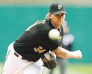 Pittsburgh Pirates starting pitcher A.J. Burnett warms up before the first inning of Monday's season opener against the Chicago Cubs at PNC Park. The Cubs won, 3-1. Burnett struck out 10 in 5 2⁄3 innings.