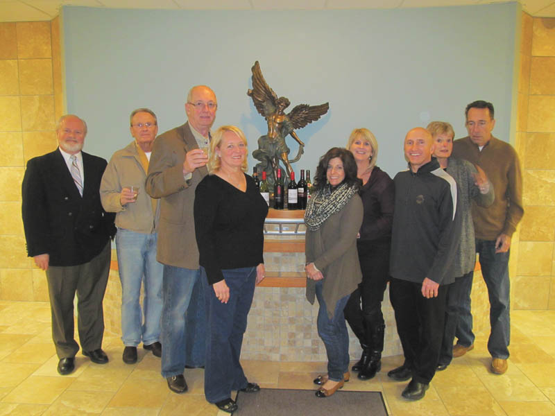 St. Michael Church sets benefit wine taste Members of St. Michael Church Wine Taste Committee pose in front of the statue of the church's patron saint as they prepare for the seventh annual St. Michael Church Family Life Center Benefit Wine Taste. Among  committee members are, from left, Chuck Wirtz, Mike Fagan, Jim and Maxine Gordon, Michelle Billy, Sharon Fischer, Mark Billy and Audrey and Mike Geskey. The event will take place at 7 p.m. April 19 in the Family Life Center, 300 N. Broad St., Canfield. Proceeds will help pay for the center's mortgage. Tickets are $50 per person and are available from committee members or by calling the church office at 330-533-6839. Wines from northeast Ohio will be paired with food by The Embassy and parishioners Mike and Karen Naffah. There will be auction items and a raffle drawing. SPECIAL TO THE VINDICATOR