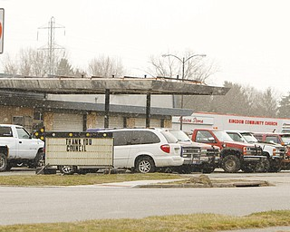 Struthers Mayor Terry P. Stocker has vetoed a resolution that would honor the owner of Charlie's Service Station, above, located in front of the Struthers Plaza on Fifth Street. Stocker said the business is an eyesore to the community because of the dilapidated vehicles parked around it.