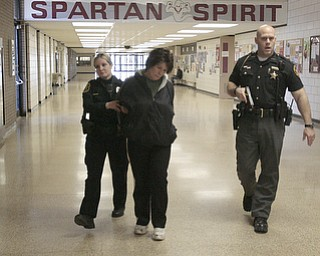 ROBERT K. YOSAY  | THE VINDICATOR..Ptl Heather Englert and Sheriff Deputy ----  walk one of the shooters from the building - .after discovering her in the school office..( BPD and area law enforcement had a mock drill of a shooter at Boardman High School - .. - -30-..