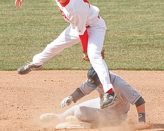 Youngstown State's Phil Lipari (13) tags out Akron's Kris Simonton (7) in a double play during the Penguins'