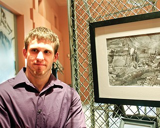 """Clayton Ruminski, a YSU graduate student studying history, is hosting a photo exhibit at the Youngstown Historical Center of Industry and Labor titled """"Iron Valley: A Century of Change at the Hubbard Furnace."""""""