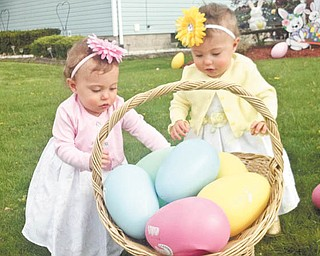 Olive and Ellie Kotarski look like they're working together for that big basket of extra-large eggs. Photo submitted by Jason Kotarski.
