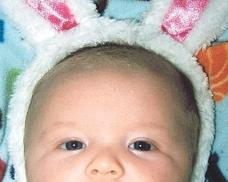Wesley Clowser is just 3 months old when he borrowed the Easter Bunny's ears this year.
