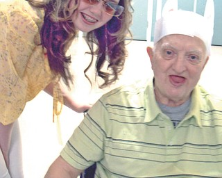 """Katrina Wolfe of Columbiana sent in this photo of her daughter, KayLee Whistler, 14, and her father, Daniel Wolfe Sr., 75, from Easter 2012. That Easter outing and dinner was her father's last one, as he passed away in July 2012, and it was memorable. Katrina writes, """"He came rolling around the corner with these handmade Easter bunny ears. We couldn't stop laughing!"""""""