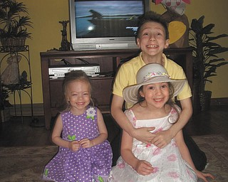Logan, Erin and Caitlin Rowland from Liberty Township are at grandma's house for Easter 2012.