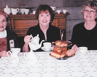 SPECIAL TO THE VINDICATOR Austintown Historical Society is sponsoring its 23rd Spring Tea on April 21 at the Strock Stone House, 7171 Mahoning Ave., Austintown. Enjoying a cup of tea while making plans are, from left,  Rae Jeanne Mollica, Marge Goldner and Joyce Pogany. Seatings will be at noon, 2 and 4 p.m., and the menu will include coffees and teas, finger sandwiches, scones, pastries and items of a traditional high tea. Tickets are $14 per person and $7 for children under 12; reservations are required by Friday. Make checks payable to Austintown Historical Society, and mail to 1181 S. Raccoon Road, Austintown, OH 44515, or call Pogany at 330-792-1129. There will be a basket raffle; winners do not need to be present to win. Free tours of the stone house will be conducted after each seating.