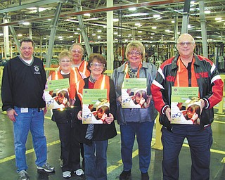 SPECIAL TO THE VINDICATOR Boardman Lions Club will extend its eyeglass collection effort through a partnership with the Lordstown General Motors Plant, placing five collection boxes inside through the efforts of United Auto Workers Local 1714 President Dave Green, also a Boardman Lion. The boxes are located at Lordstown's main entrances and at the safety department. More than 1,750 pairs of glasses have been collected by the club since September to be redistributed through LensCrafters to those in need. Green, left, gave a tour of the plant to Lion members Betsy Koch, Henry Koch, Patti Shears, Terri Wilkes and Ron Paris.