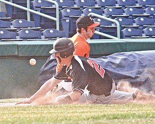 Canfield's Jimmy Leone (21) knocks the ball loose after he collides with Howland's Vinny Ruberto at third base during Monday's game at Eastwood Field in Niles. The Tigers edged the Cardinals, 9-8.