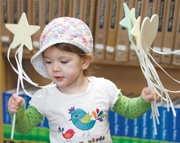 Katherine DePinto, 2, uses ribbons on stars and hearts as she dances to a song during the Gotta Move storytime at the Canfield library. Children age 2-5 joined for a variety of musical and movement activities that are designed to stimulate brain development and motivate language learning.