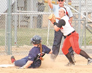 YSU's Samantha Snodgrass (6) looks to throw to first base after tagging out Sarah Cupp (12) at third during the  first game of a doubleheader on Tuesday at McCune Park in Canfield. The Penguins won the first game, 5-0. Detroit took the second, 4-2.