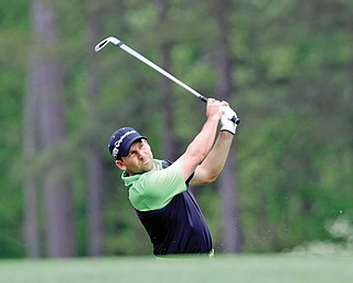Spain's Sergio Garcia hits his tee shot to the 12th green Thursday during the first round of The Masters at Augusta National Golf Club in Augusta, Ga. Garcia matched his best Masters score — a 6-under 66 —to surge up the leaderboard and into a two-way tie for first place with Australia's Marc Leishman.