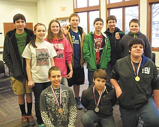 SPECIAL TO THE VINDICATOR Students in Marcia Duko's seventh- and eighth-grade classes at Leetonia Middle School participated in the recent Limerick Fest at Leetonia Community Library. Kneeling in front from left are, Nick Carroll, third place; John Sipahioglu, second place; and Zach Pugh, first place. Standing are Caleb Witmer, Jeneca Shar, Zoe Braderly, Coaltin Barcey, Tyler Hephner, Derrick Grossen and Austin Hicks.