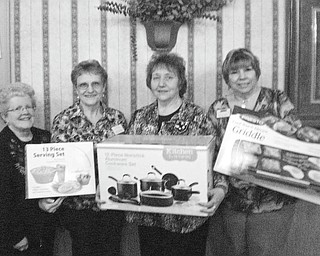 SPECIAL TO THE VINDICATOR The annual basket auction for Mill Creek Chapter of American Business Women's Association will be from 12:30 to 4 p.m. April 28 at the Ursuline Center, 4280 Shields Road, Canfield. Members showing sample gifts are, from left, Judy Codespote, Jackie Fischio, Kathy Novak and Marilyn Abramski. Doors will open at 12:30 with drawings starting at 3. Ticket holders are entitled to free refreshments. There will be gifts for children, men and women and special raffles of items greater than $25. The donation for a ticket is $5 and can be purchased at the door. Call Codespote at 330-502-9413 for tickets before the event. All proceeds will go to the education fund, which sponsors youth  attending Youngstown State, Kent State and John Carroll universities.