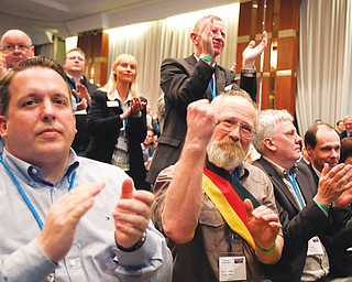 Members of the new anti-Euro party Alternative for Germany react during the party's founding convention in Berlin, Germany, on Sunday. The organizers had to open a second room to squeeze in more than 1,500 members who had come from across the country to adopt a program and vote for a party board.