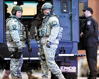 SWAT team members stand guard on the campus of Massachusetts General Hospital after an explosion near the finish line of the Boston Marathon.