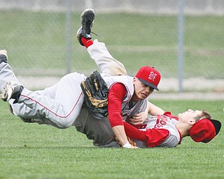 Niles outfielders Ian Hileman, left, and Justin Lopes collide after trying to catch a fly ball that was hit by Struthers' Gary Muntean in the first inning of a game Monday at Cene Park in Struthers.