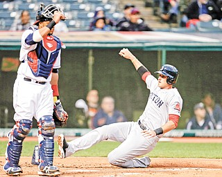 Boston's Will Middlebrooks slides home against the Cleveland Indians on a sacrifice fly by Pedro Ciriaco in the second inning of a game Tuesday in Cleveland. The Red Sox won, 7-2.