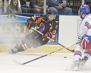 Phantoms defenseman Ryan Lowney moves to keep the puck away from Des Moines' Luke Voltin during a game at the Covelli Centre. Lowney is one of the Phantoms' penalty killers. Their unit is ranked first in the USHL.