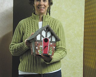 SPECIAL TO THE VINDICATOR Shari Fry is holding a Tudor birdhouse she created for the birdhouse decorating contest sponsored by Springtime in Columbiana set for May 3 and 4 on Main Street.