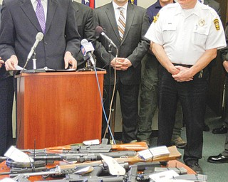 U.S. Attorney Steven M. Dettelbach reveals the results of an investigation and explains why close to 200 agents fanned out across Warren and arrested 65 people. Officials said they put a major dent in a Detroit-to-Warren drug-and guns operation. At right is Warren Police Chief Tim Bowers.