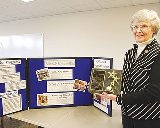 Sister Patricia McNicholas is leaving her position as executive director of Beatitude House. At left, she's holding