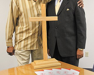 The Rev. Henry L. McNeil, left, serves as president of the Economic Empowerment Steering Committee of the Community of Faith Credit Union with the Rev. Kenneth Simon as vice president. Brochures about the COFCU are on the table. This week, a letter campaign begins to raise funds.