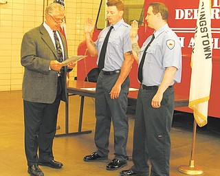 Mayor Charles Sammarone, left, promoted Youngstown City firefighters Mark Kellerman, center, and Tim Hrina, to the rank of lieutenant Wednesday.