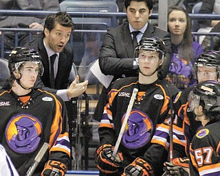 Phantoms second-year head coach Anthony Noreen discusses strategy with forward John Padulo (57) during a regular-season game at the Covelli Centre. Noreen's third-seeded Phantoms take on the top-seeded Dubuque Fighting Saints for the USHL East Conference title in a best-of-five game series that begins Friday in Dubuque, Iowa.